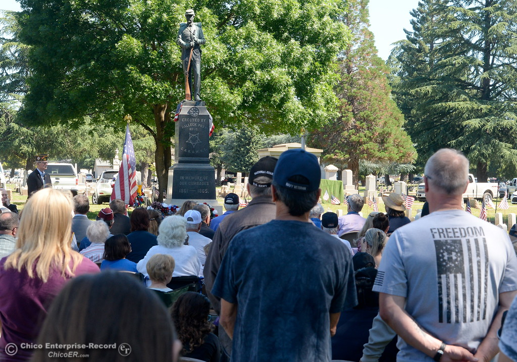 ". Veteran Rick Schortgen of Chico stands at right with a ""Freedom\"" shirt during the Memorial Day Ceremony held at the Chico Cemetery in Chico, Calif. Monday, May 28, 2018. (Bill Husa -- Enterprise-Record)"