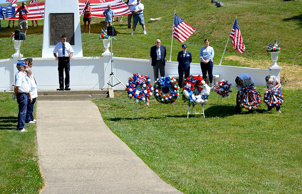 American Legion Post 120 Commander David Mahon announces the placing of the wreaths by area veterans organizations during the Memorial Day Ceremonies held at Oakridge Cemetery in Effingham on Monday morning. Charles Mills photo