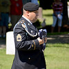 SFC Chad Soltwedel representing the Illinois Army National Guard, Bravo Company, 2nd Battalion, 130th Infantry presents the U.S. Flag to be raised during Memorial Day Ceremonies held Monday morning at Oakridge Cemetery in Effingham. Charles Mills photo