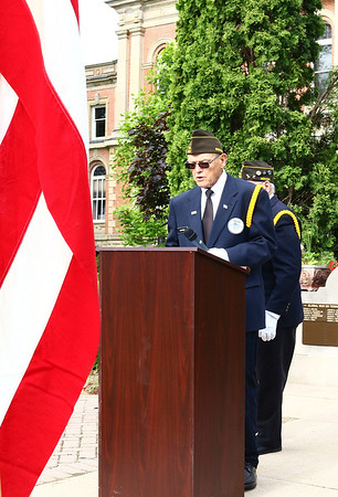 VFW chaplain John Alheim leads the group assembled at the Elkhart County War Memorial in prayer Monday morning during Memorial Day services.