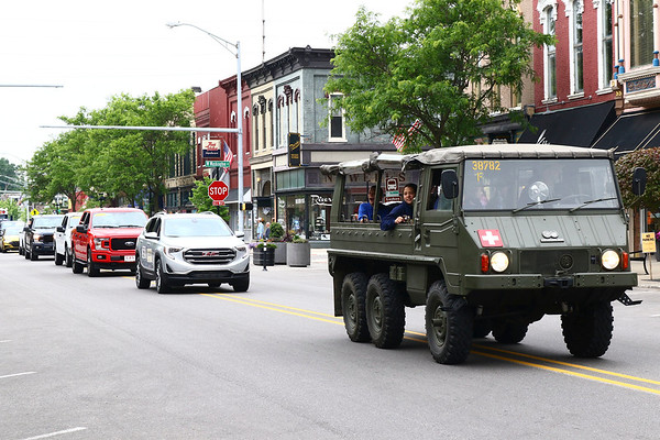 A privately owned Pinzgauer high-mobility all-terrain vehicle outfitted as a first aid vehicle rolls through downtown Goshen as part of the annual Memorial Day parade Monday.
