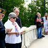Jan Santos, Veterans of Foreign Wars Auxiliary president, speaks at the Lincoln Avenue bridge in Goshen Monday morning before county Veteran Affairs officer Jim Snowden, to her right, throws the wreath into the Elkhart River in memory of those Navy veteran who died in service to the United States. To Santos' left is VFW Commander George Buckmanster.