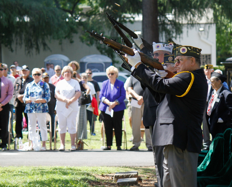 . The Chico Veterans Honor Guard conduct the firing detail to honor fallen soldiers during the Memorial Day Ceremony Monday May 29, 2017 at the Chico Cemetery in Chico, California. (Emily Bertolino -- Enterprise-Record)