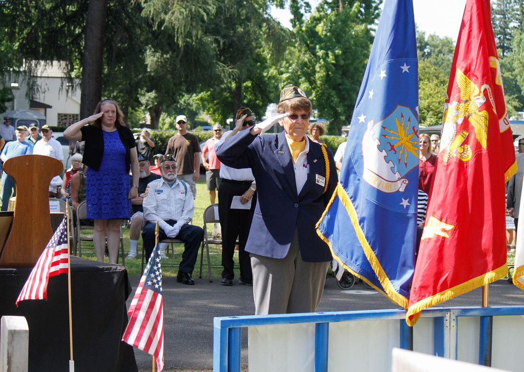 . Air Force Veteran Judy Smith salutes the Air Force flag as each branch presents their flag during the Memorial Day Ceremony Monday May 29, 2017 at the Chico Cemetery in Chico, California. (Emily Bertolino -- Enterprise-Record)