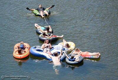Tubers enjoy the cool water in the Feather River seen floating downstream during the Memorial Day Ceremony on the Green Bridge in Oroville, Calif. Mon. May 30, 2016. (Bill Husa -- Enterprise-Record)