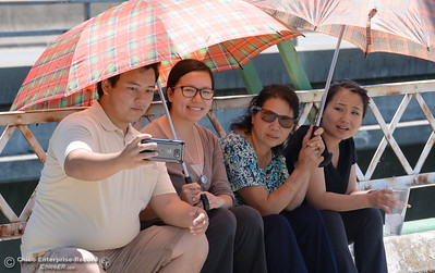 Members of the Yang Family, left to right, Danny, Xay, Soua and Mee smile for a selfie during the Memorial Day Ceremony on the Green Bridge in Oroville, Calif. Mon. May 30, 2016. (Bill Husa -- Enterprise-Record)
