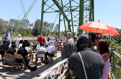 Guest keep cool with the shade of an umbrella during the Memorial Day Ceremony on the Green Bridge in Oroville, Calif. Mon. May 30, 2016. (Bill Husa -- Enterprise-Record)