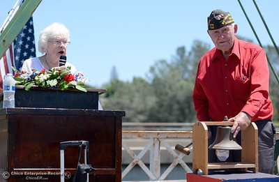Sherry and Bob Morehouse read names and ring the bell during the tolling if the bell during the Memorial Day Ceremony on the Green Bridge in Oroville, Calif. Mon. May 30, 2016. (Bill Husa -- Enterprise-Record)