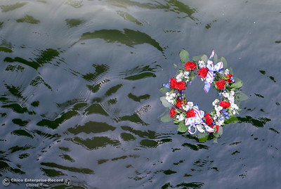 The ceremonial wreath floats downstream in the Feather River during the Memorial Day Ceremony on the Green Bridge in Oroville, Calif. Mon. May 30, 2016. (Bill Husa -- Enterprise-Record)
