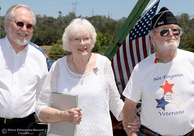 Band Leader Bob Christensen at left smiles with Sherry Morehouse and Stu Shaner during the Memorial Day Ceremony on the Green Bridge in Oroville, Calif. Mon. May 30, 2016. (Bill Husa -- Enterprise-Record)