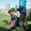 Noah Torres, 11, and Joseph Ellenbaas, 10, from Boy Scout Troop 12 flag the graves of veterans at St. Leo's Cemetery in Leominster on Saturday, May 27, 2017 ahead of Memorial Day weekend. SENTINEL & ENTERPRISE / Ashley Green