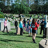 Local boy and girl scouts troops, as well as a group from St. Anna's, joined together to flag the graves of veterans at St. Leo's Cemetery in Leominster on Saturday, May 27, 2017 ahead of Memorial Day weekend. SENTINEL & ENTERPRISE / Ashley Green