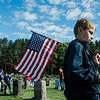 Karl Uschold, 8, from Cub Scout Pack 3, flags the graves of veterans at St. Leo's Cemetery in Leominster on Saturday, May 27, 2017 ahead of Memorial Day weekend. SENTINEL & ENTERPRISE / Ashley Green