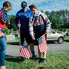 Beth Pallotta, Joseph Pallotta and Andrew Gardner, from St. Anna's, flag the graves of veterans at St. Leo's Cemetery in Leominster on Saturday, May 27, 2017 ahead of Memorial Day weekend. SENTINEL & ENTERPRISE / Ashley Green