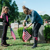 Abby Muller and Dense Permattero, from Cub Scout Pack 3, flag the graves of veterans at St. Leo's Cemetery in Leominster on Saturday, May 27, 2017 ahead of Memorial Day weekend. SENTINEL & ENTERPRISE / Ashley Green