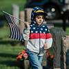 Carlos Castano, 7, from Cub Scout Pack 3, flags the graves of veterans at St. Leo's Cemetery in Leominster on Saturday, May 27, 2017 ahead of Memorial Day weekend. SENTINEL & ENTERPRISE / Ashley Green