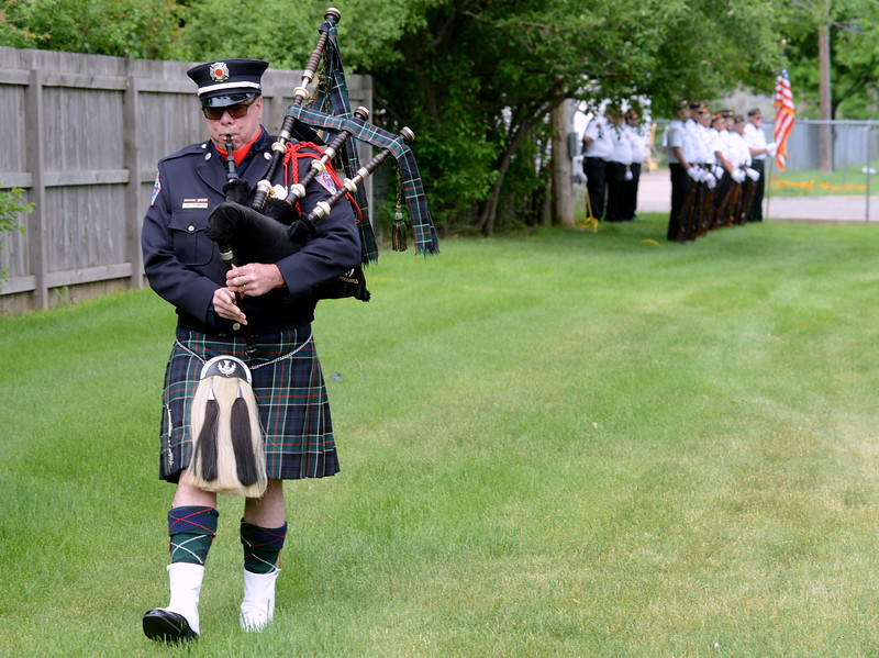 """Bagpiper John Bergquist plays """"Amazing Grace"""" at the end of the Memorial Day ceremony at Loveland Burial Park on Monday morning, May 28, 2018. (Photo by Craig Young / Loveland Reporter-Herald)"""