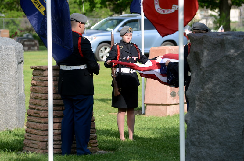 Bella Norris, center, and fellow Junior Reserve Officers' Training Corps cadets from Loveland High School, Brenden Hill, Josh Calhoun and Casey North, prepare to raise the American flag during the Memorial Day ceremony at Loveland Burial Park on Monday morning, May 28, 2018. (Photo by Craig Young / Loveland Reporter-Herald)