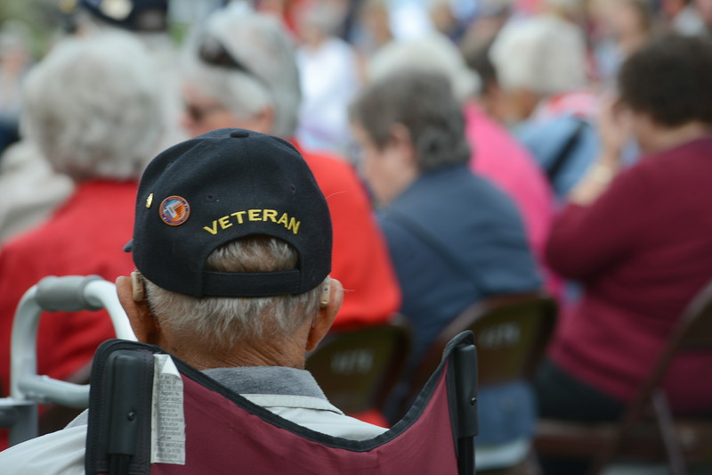 Loveland resident Bernie Nettesheim, a veteran of World War II, listens to a speaker during  the Memorial Day ceremony at Loveland Burial Park on Monday morning, May 28, 2018. (Photo by Craig Young / Loveland Reporter-Herald)