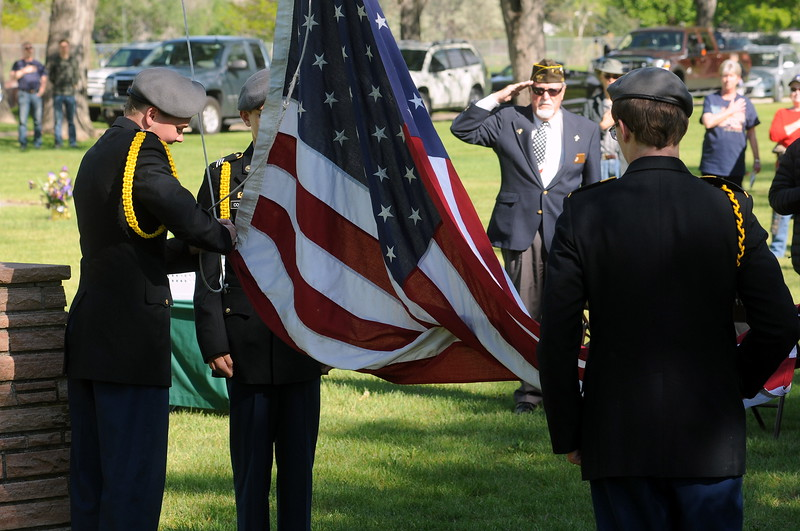 Charlie Nash, chaplain of the Associated Veterans of Loveland, salutes the flag as the Junior ROTC color guard from Thompson Valley High School prepares to raise it during the Memorial Day service on Monday, May 29, 2017, at Loveland Burial Park. From left they are Sean Bills, Alex Coleman, Joseph Itzen and (not shown) Abigayle Wing. (Photo by Craig Young / Loveland Reporter-Herald)