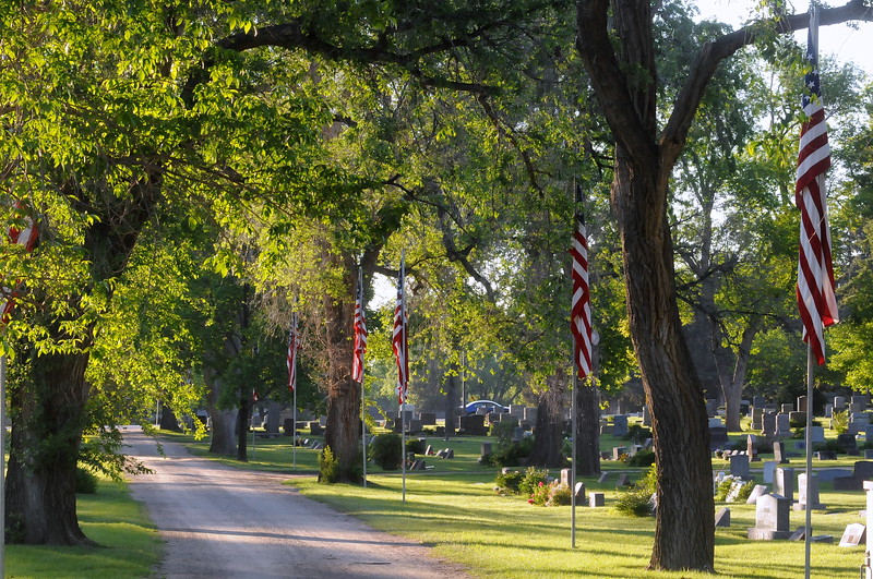 With about 60 American flags raised by 6 a.m. Monday, May 29, 2017, Loveland Burial Park sits in silence before the arrival of people to commemorate Memorial Day and to work on the grave sites of their loved ones. (Photo by Craig Young / Loveland Reporter-Herald)