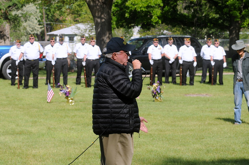 Fort Collins resident Robert Wideman, guest speaker at the Memorial Day service Monday, May 29, 2017, at Loveland Burial Park, talks about his experiences as a prisoner of war during the Vietnam War as members of the Associated Veterans of Loveland color guard stand in the background. (Photo by Craig Young / Loveland Reporter-Herald)