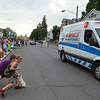 MARK ROBARGE - mrobarge@troyrecord.com<br /> Children swoop in to collect candy tossed from an Empire Ambulance Service rig during the annual Memorial Day parade in Cohoes on Thursday night.