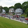 MARK ROBARGE - mrobarge@troyrecord.com<br /> Emergency apparatus from the Cohoes and Menands fire departments and Empire Ambulance Service make their way down Columbia Street in Cohoes during the city's annual Memorial Day parade on Thursday night.