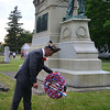 MARK ROBARGE - mrobarge@troyrecord.com<br /> Grand marshal Leo Falconio lays a wreath at the foot of the Cohoes Tribute Civil War monument to kick off the city's annual Memorial Day parade on Thursday night.