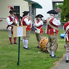 MARK ROBARGE - mrobarge@troyrecord.com<br /> The Village Volunteers Fife and Drum Corps from Delmar warm up before the annual Memorial Day parade in Cohoes on Thursday night.