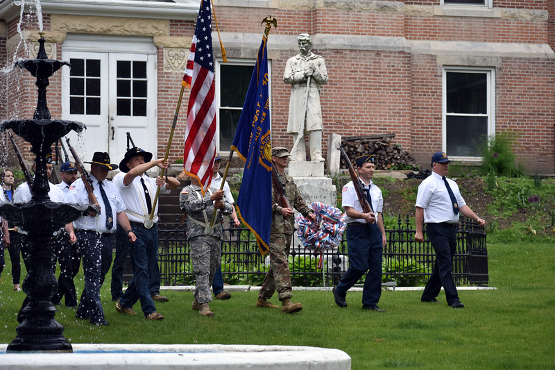 HOLLY PELCZYNSKI - BENNINGTON BANNER Active service memebers and members of the Veterans of Foreign Wars and the Legion Auxiliaries march to Wood Memorial Park on Monday, in observation of Memorial Day in Hoosick Falls NY.