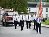 HOLLY PELCZYNSKI - BENNINGTON BANNER Members of the Veterans of Foreign Wars and the Legion Auxiliaries march down Buck Hill Road on Monday, in observation of Memorial Day in Shaftsbury VT.