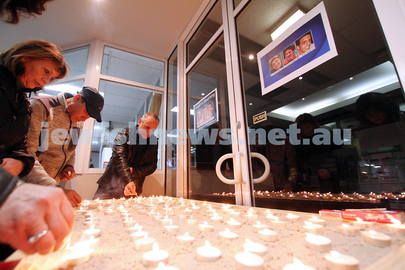 1-7-14. Memorial service at Beth Weizmann for the murdered Israeli teenagers Naftali Frenkel, Gilad Shaar and Eyal Yifrach. Mourners lighting candles. Photo: Peter Haskin
