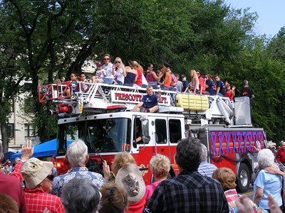 Families of the fallen firefighters rode on the ladder truck