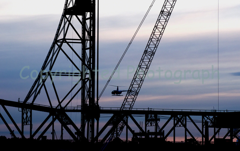 An eerie calm settles over the scene  as the Memorial Bridge's  center span awaits separation from its Portsmouth, NH and Kittery, Me towers.-February 8,2012