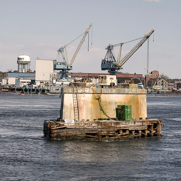 The Portsmouth outer  buttress, or pier, which once supported the south span and tower, is all that remains of the Portsmouth side of the Memorial bridge. -April 4, 2012