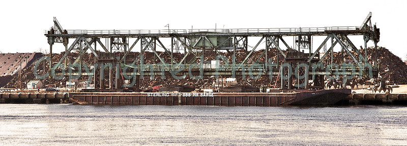 "At about 10:30 pm on February 8, 2012, before a cheering crowd(although a bittersweet moment) the 2 million pound, 302.5 ' long center span was finally separated form its two towers and floated up river to the""scrap piles pier"" where it would remain for a brief period.-February 9, 2012"