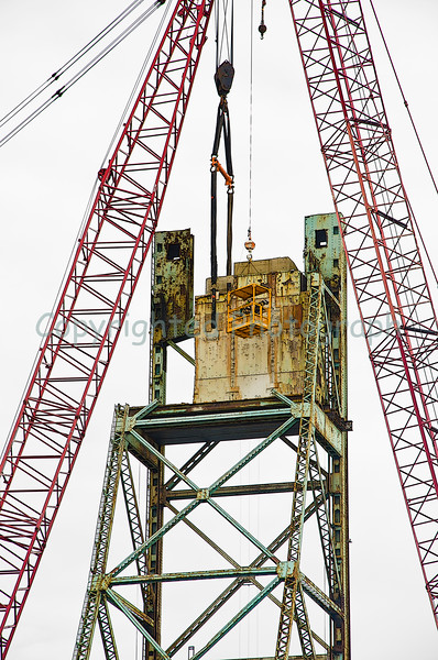 The lifting harness, attached to the second section of counter weight, is capable of lifting 140 tons. With everything in place and a final inspection underway, the second section will soon be removed with much less fanfare than the first. Note that the left end section of steel has been removed allowing Excalibur a better approach and added removal options. -March 23, 2012