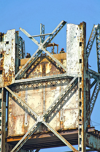 Workers atop the Kittery tower continue preparing sections of steel for removal. Notice the steel girders supporting the counterweight now that the center span suspension cables have been cut.- March 12, 2012