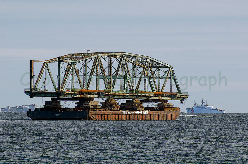 With Star Island in the background, and a few of the Coast Guard vessels as temporary escorts, The Portsmouth Memorial Bridge's south span is well on her way. -March 31, 2012