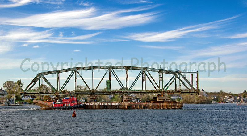 """As bagpipes chant """"Amazing Grace"""", the north span's procession continues. That's Kittery, Me in the background . -April 28, 2012"""