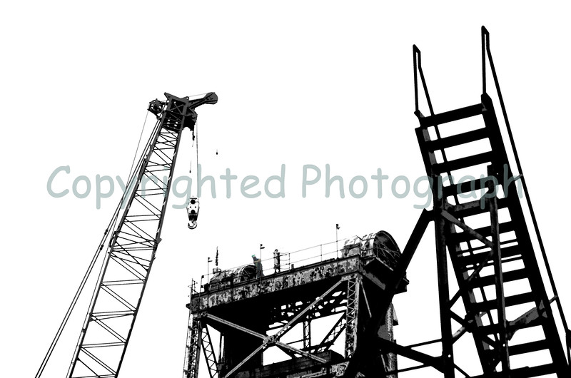 The Memorial Bridge Portsmouth tower, the iron stairs leading up from the center span and the massive crane head; symbols now, of times past and present.-February 14, 2012