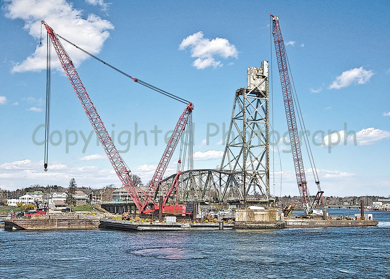 "Excalibur, having removed the first of the Kittery tower's four counterweight sections, must take a break. It seems that one of her lifting cables has frayed which makes for very unsafe lifting.She will be moved to the ""salt piles pier"" for repairs once again. April 4, 2012"
