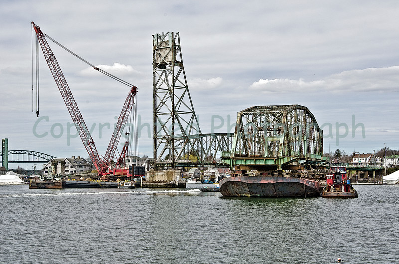 Once in the channel, the Memorial Bridge's south span is rotated so that her Portsmouth end faces the city she has served faithfully for nearly 90 years.  A cheering crowd bids her a fond farewell and final salute as an act of thanks and God's Speed. March 31, 2012.