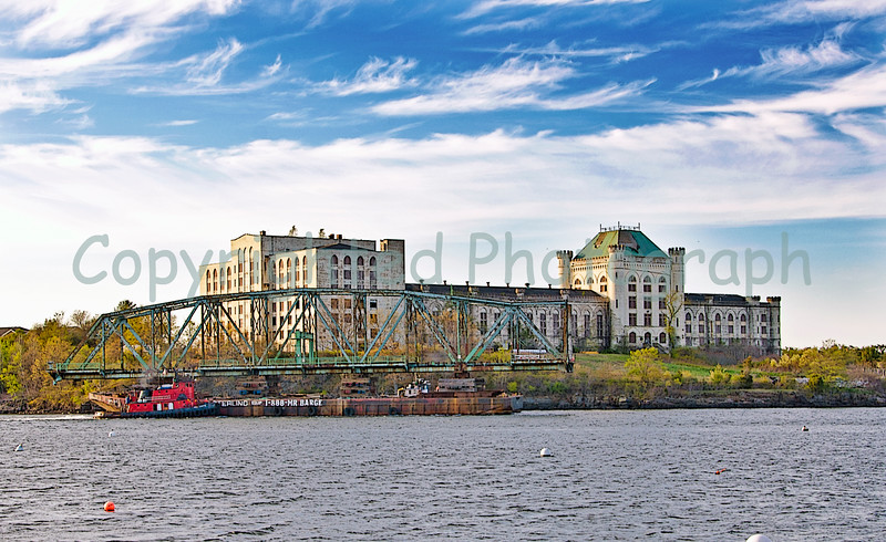 The Memorial Bridge's north span continues her journey, passing by the old naval prison(The Castle). Guiding her are the Miss Yvette on her starboard side and the Creole Miss on her port side. -April 28, 2012.