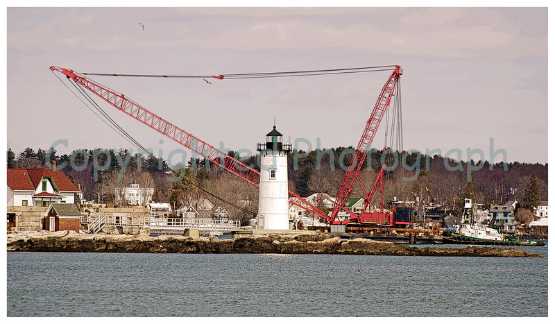 Excalibur passes by Fort Point Lighthouse. -March 5, 2012