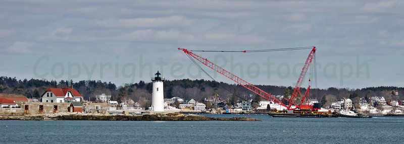 As she approaches Fort Point Light(Constitution to some) , Excalibur, like some lumbering prehistoric behemoth, continues her journey up the Piscataqua River. -March 5, 2012