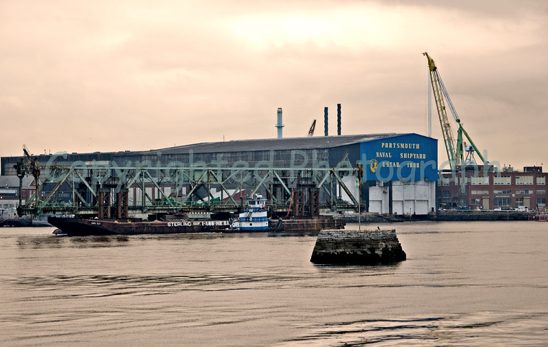 The Memorial Bridge's center span's procession continues past the Shipyard as it makes its way to the open ocean.The mood is somber as the center span passes by the small pockets of onlookers that have gathered for this occasion. Few thought they would ever live to see this day. Goodbye old friend-February 15, 2012