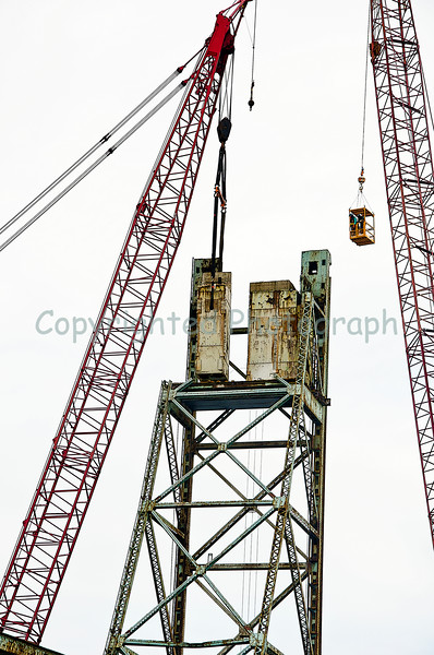 Up we go! The second section of counterweight is hoisted off the Portsmouth tower.