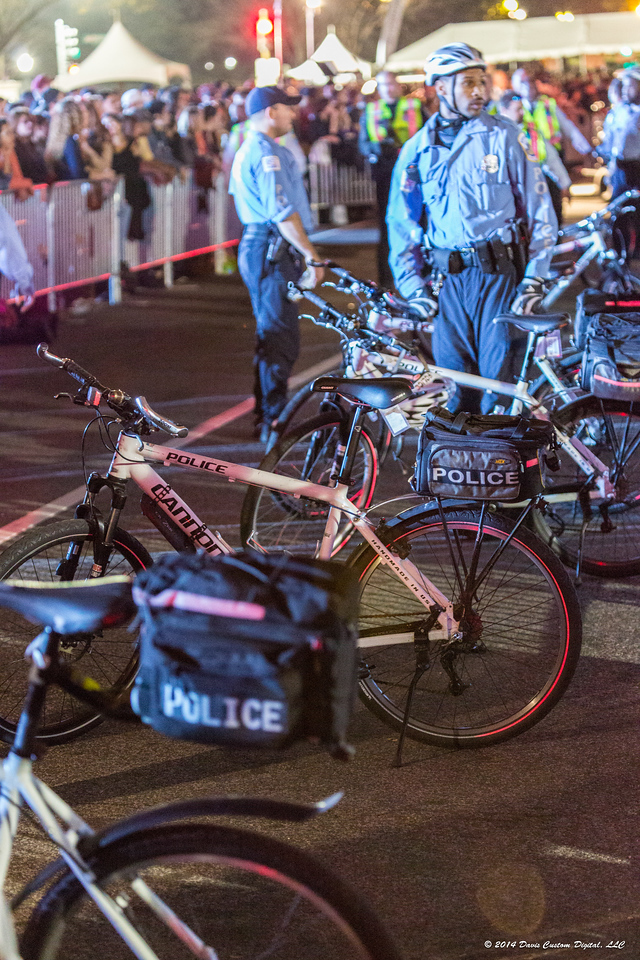 The armed security teams with their black suburbans was replaced by the D. C. police bike patrol.